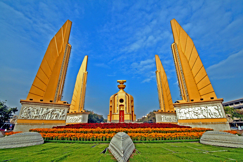 Democracy Monument, Bangkok, Thailand.  Built in 1940, the Democracy Monument in central Bangkok was designed by Corrado Feroci, who spent much of the 1920s designing monuments for Italian fascist dictator Benito Mussolini. It commemorates the 1932 revolution which ended the absolute monarchy and established Thailand's first constitution.
