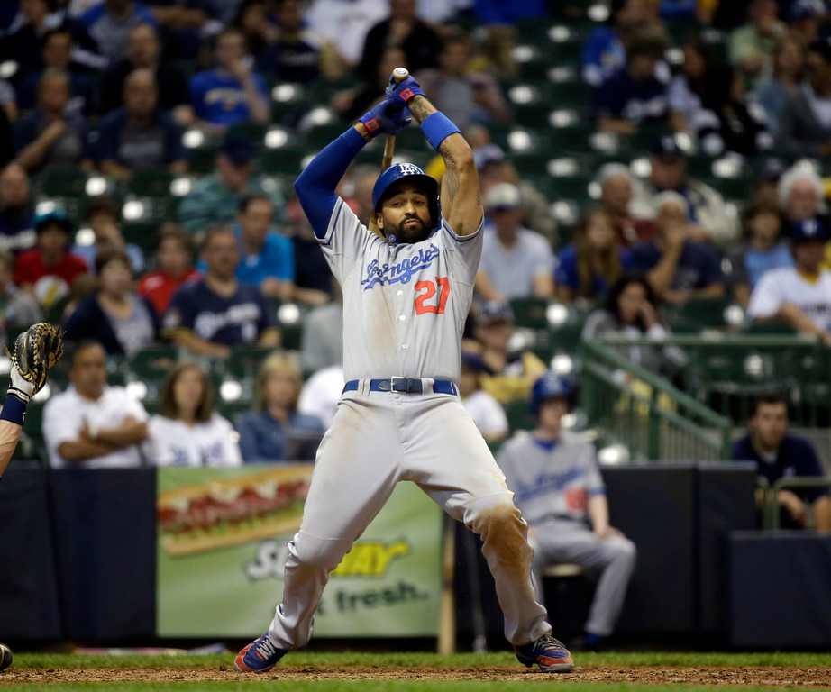 . Los Angeles Dodgers\' Matt Kemp gets out of the way of an inside pitch during the ninth inning of a baseball game against the Milwaukee Brewers Wednesday, May 22, 2013, in Milwaukee. (AP Photo/Morry Gash)