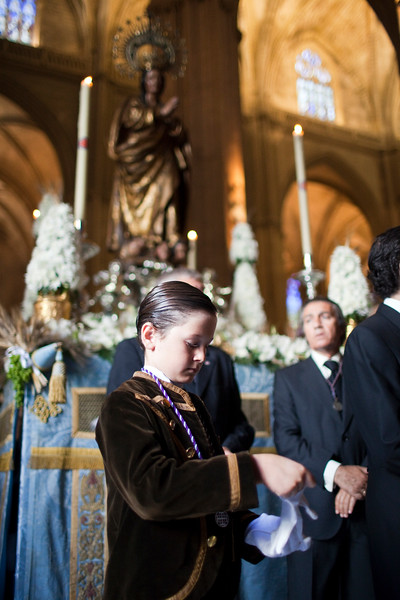 Altar boy in front of a float with the Virgin, Corpus Christi procession, Cathedral of Seville, Spain, 2009.
