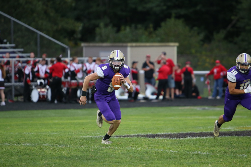 . Kyle Sooy - The Morning Journal<br> Vermilion quarterback Seth Hurd runs the ball against Firelands on Sept. 7.