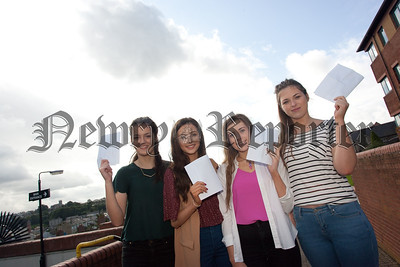 Pictured are top students Eimear Murphy (10A*) and Rebecca Kearney (9A*) flanked by the McNally twins Fiona and Grainne who have 19 A/A* grades between them. R1535019