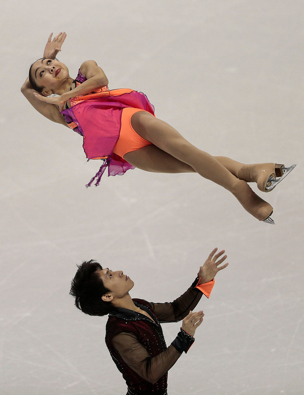 . Wenjing Sui And Cong Han of China skate their short program in the pairs competition at the 2013 World Figure Skating Championships in London, Ontario, March 13, 2013. GEOFF ROBINS/AFP/Getty Images