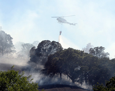 Photos: Crews battle four-alarm grass fire in Winters