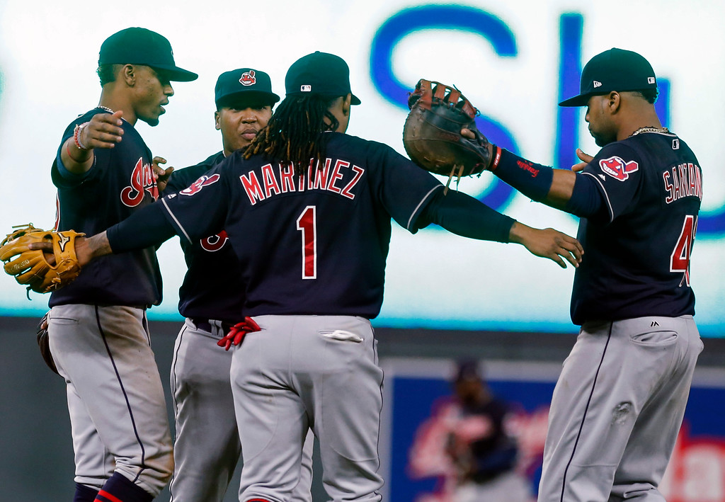 . Cleveland Indians players celebrate the team\'s 11-4 win over the Minnesota Twins in a baseball game Tuesday, April 18, 2017, in Minneapolis. From left are Francisco Lindor, Jose Ramirez, Michael Martinez and Carlos Santana. (AP Photo/Jim Mone)