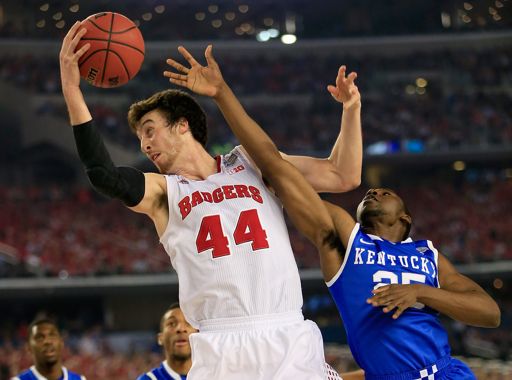 . ARLINGTON, TX - APRIL 05: Frank Kaminsky #44 of the Wisconsin Badgers grabs a rebound over Dominique Hawkins #25 of the Kentucky Wildcats  during the NCAA Men\'s Final Four Semifinal at AT&T Stadium on April 5, 2014 in Arlington, Texas.  (Photo by Jamie Squire/Getty Images)