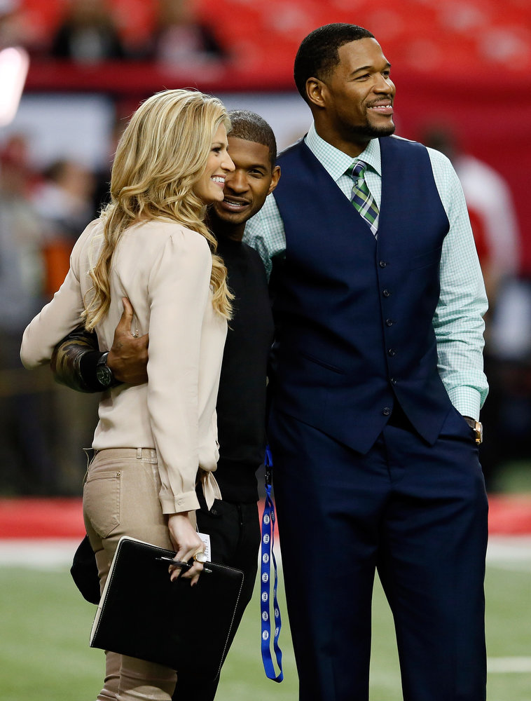 Description of . Fox Sports reporter and host Erin Andrews, singer Usher and Fox Sports NFL analyst Michael Strahan stand on the field prior to the Atlanta Falcons hosting the San Francisco 49ers in the NFC Championship game at the Georgia Dome on January 20, 2013 in Atlanta, Georgia.  (Photo by Kevin C. Cox/Getty Images)