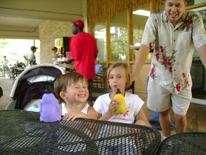 Tate (smiling for the camera), Summer (drinking her drink) and Michael.