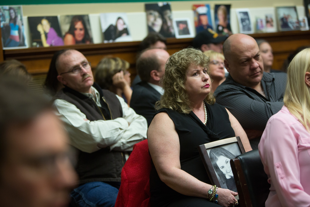 """. Mary Theresa Ruddy holds a photo of her daughter Kelly Erin Ruddy, who was 21 when she died in a car accident in 2010 involving her 2005 Chevy Cobalt, as General Motors CEO Mary Barra testifies before the full House Energy and Commerce hearing room in a hearing entitled \""""The GM Ignition Switch Recall: Why Did It Take So Long?\"""" on Capitol Hill April 1, 2014 on Capitol Hill in Washington, DC.  The committee is hearing testimony on a safety defect that\'s been linked to at least 13 deaths and has sparked a 2.6 million-vehicle recall. (Photo by Allison Shelley/Getty Images)"""