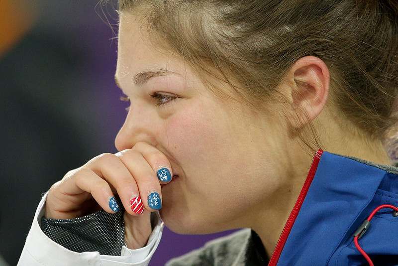 . United States\' Ashley Caldwell gets emotional as she talks with head aerial coach Todd Ossian, not pictured, after the women\'s freestyle skiing aerials final at the Rosa Khutor Extreme Park, at the 2014 Winter Olympics, Friday, Feb. 14, 2014, in Krasnaya Polyana, Russia. Caldwell was eliminated after the final 1. (AP Photo/Jae C. Hong)