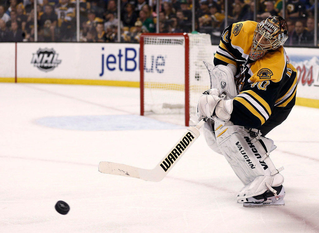 . Boston Bruins goalie Tuukka Rask clears the puck against the Pittsburgh Penguins during the third period in Game 3 of their NHL Eastern Conference finals hockey playoff series in Boston, Massachusetts, June 5, 2013. REUTERS/Winslow Townson