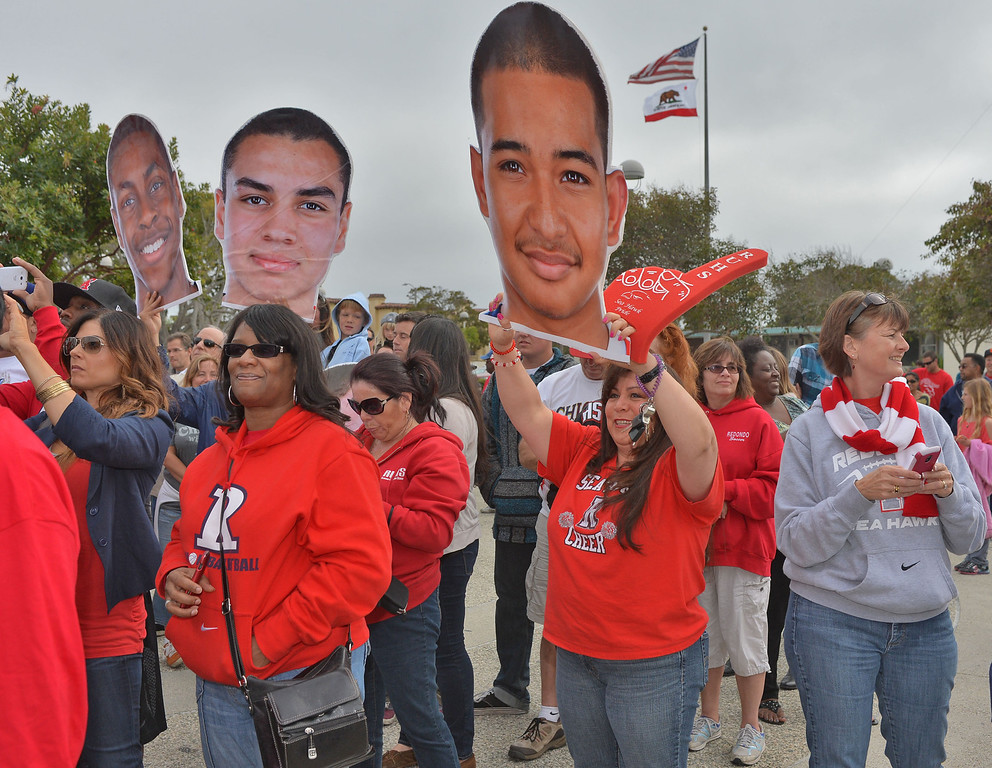 . TBR29-RUHS_PARADE--- Redondo Beach, CALIFORNIA--3/28/13--- Staff Photo: Robert Casillas / LANG---  The Redondo Union High basketball team was celebrated Thursday for their CIF State title. The festivities began with a double decker bus ride around the school and a rally at City Hall. Parents and fans holding big heads watch festivities.