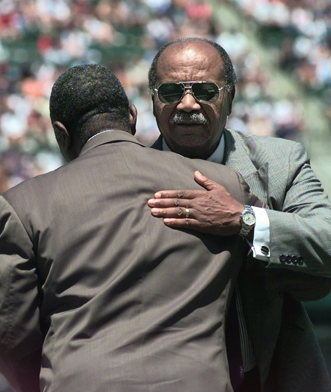 . Larry Doby, right, hugs Hank Aaron during pre-game ceremonies in Cleveland Saturday, July 5, 1997, marking the 50th anniversary of Doby breaking the color barrier in the American League. (AP Photo/Mark Duncan)