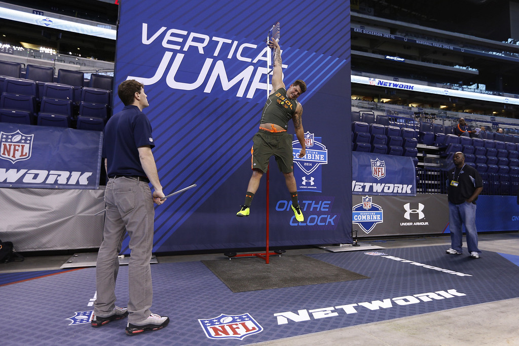. Former Michigan offensive lineman Taylor Lewan takes part in the vertical jump drill during the 2014 NFL Combine at Lucas Oil Stadium on February 22, 2014 in Indianapolis, Indiana. (Photo by Joe Robbins/Getty Images)