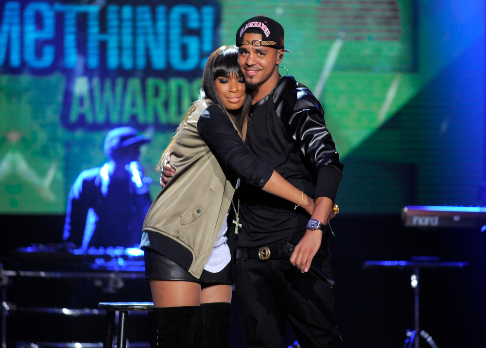 . Jennifer Hudson, left, and J. Cole hug on stage at the Do Something Awards at the Avalon on Wednesday, July 31, 2013, in Los Angeles. (Photo by Chris Pizzello/Invision/AP)