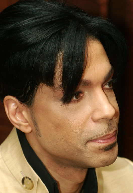 ". Musician Prince speaks at a media conference for the release of his new video, ""Te Amo Corazon\"" at the Regent Beverly Wilshire Hotel on December 13, 2005 in Beverly Hills, California.  (Photo by Matthew Simmons/Getty Images)"