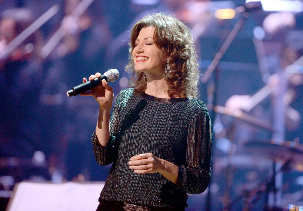 Description of . Singer Amy Grant performs onstage during a celebration of Carole King and her music to benefit Paul Newman's The Painted Turtle Camp at the Dolby Theatre on December 4, 2012 in Hollywood, California.  (Photo by Michael Buckner/Getty Images for The Painted Turtle Camp)