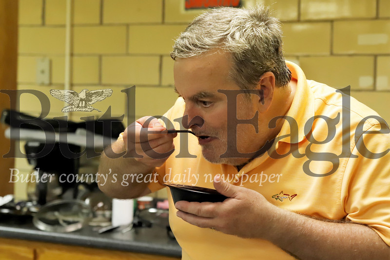 Bill Mitchell tastes one of the chili submissions. Seb Foltz/Butler Eagle