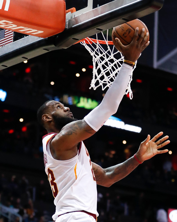 . Cleveland Cavaliers forward LeBron James (23) scores against the Atlanta Hawks during the second half of an NBA basketball game Friday, Feb. 9, 2018, in Atlanta. Cleveland won 123-107. (AP Photo/John Bazemore)