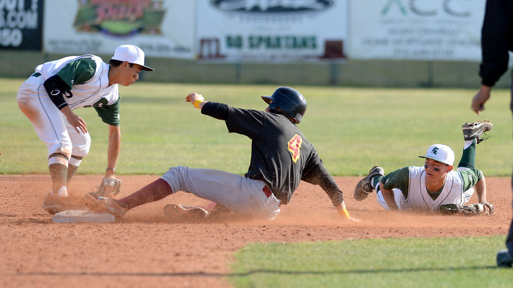 . South\'s Perry Richmond (5) tries to shuffle the ball to Kyle Henmi (2) as Estancia\'s Ben Beck (4) slides in safe at second in a first-round CIF SS Division IV baseball game Friday in Torrance. South won 7-2. 20130517 Photo by Steve McCrank / Staff Photographer