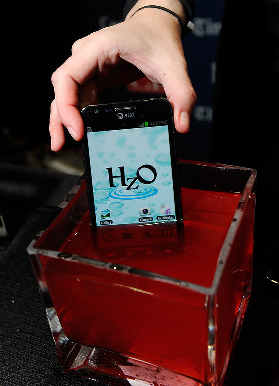 . An iPhone using HzO Waterblock technology is displayed in a bowl of water during a press event at the Mandalay Bay Convention Center for the 2013 International CES on January 6, 2013 in Las Vegas, Nevada. (Photo by David Becker/Getty Images)