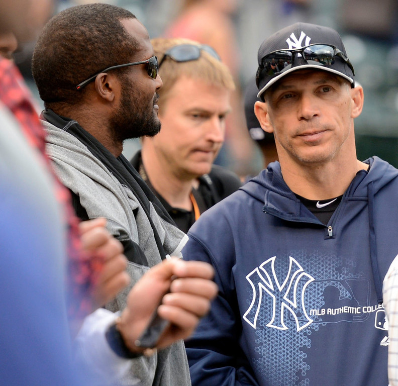 . Joe Girardi (28) of the New York Yankees chats with Denver Broncos Champ Bailey during batting practice May 7, 2013 at Coors Field. (Photo By John Leyba/The Denver Post)