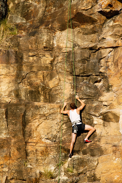 A rock climber attempts a top-rope route