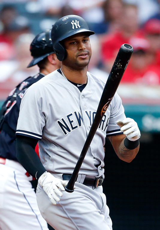 . New York Yankees\' Aaron Hicks reacts after being struck out by Cleveland Indians starting pitcher Mike Clevinger during the third inning of a baseball game, Saturday, July 14, 2018, in Cleveland. (AP Photo/Ron Schwane)