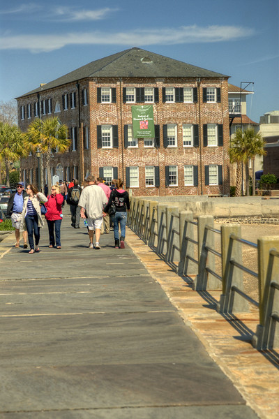 Groups of people enjoy a warm day on The Battery seawall along East Bay Street in downtown Charleston, SC on Saturday, March 9, 2013. Copyright 2013 Jason Barnette