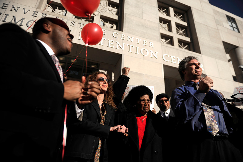 . Roxey Walton (mother of Marvin Lewis Booker) stands with supporters during a rally seeking justice for her son, who was killed during an altercation with deputies while being booked on charges of possession of drug paraphernalia in 2010. Denver Detention Center on Wednesday, March 12, 2014. (Photo By AAron Ontiveroz/ The Denver Post)