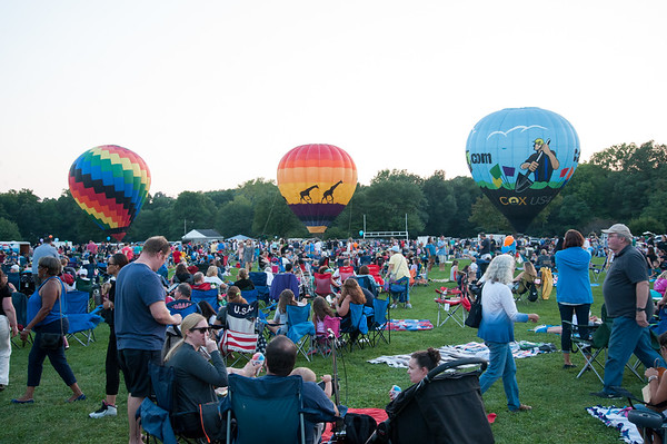 08/24/18 Wesley Bunnell | Staff Large crowds brought blankets and chairs to watch the balloons and fireworks on Friday night at the Plainville Balloon festival.
