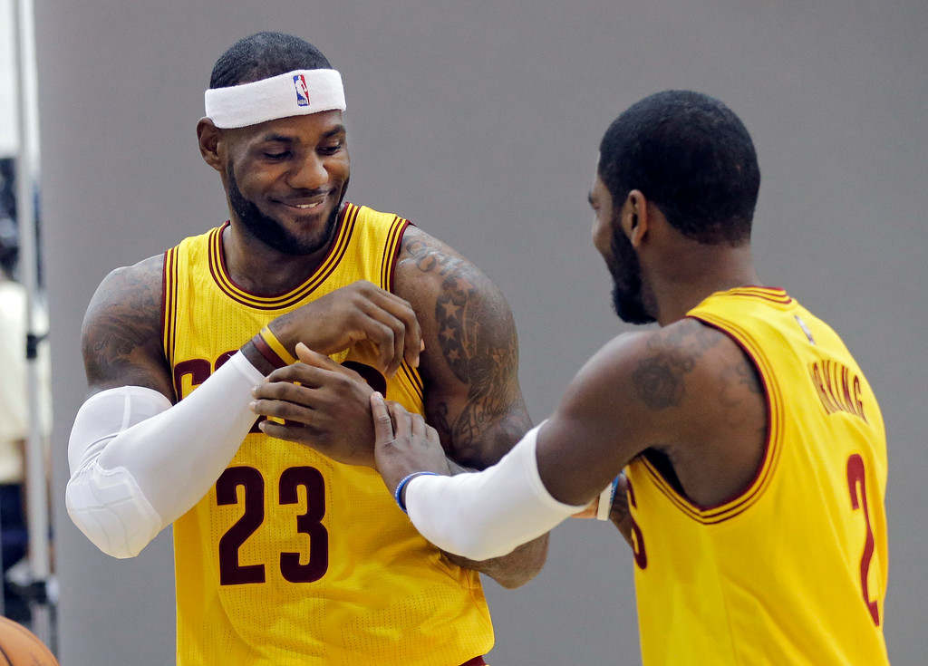 . Cleveland Cavaliers\' LeBron James (23) jokes with Kyrie Irving during the NBA basketball team\'s media day Friday, Sept. 26, 2014, in Independence, Ohio. (AP Photo/Mark Duncan)