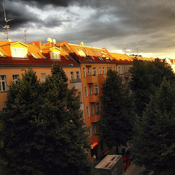 A view from our dinner table. It never rained, the sky just remained on fire until the sun disappeared. Berlin late summer eve.