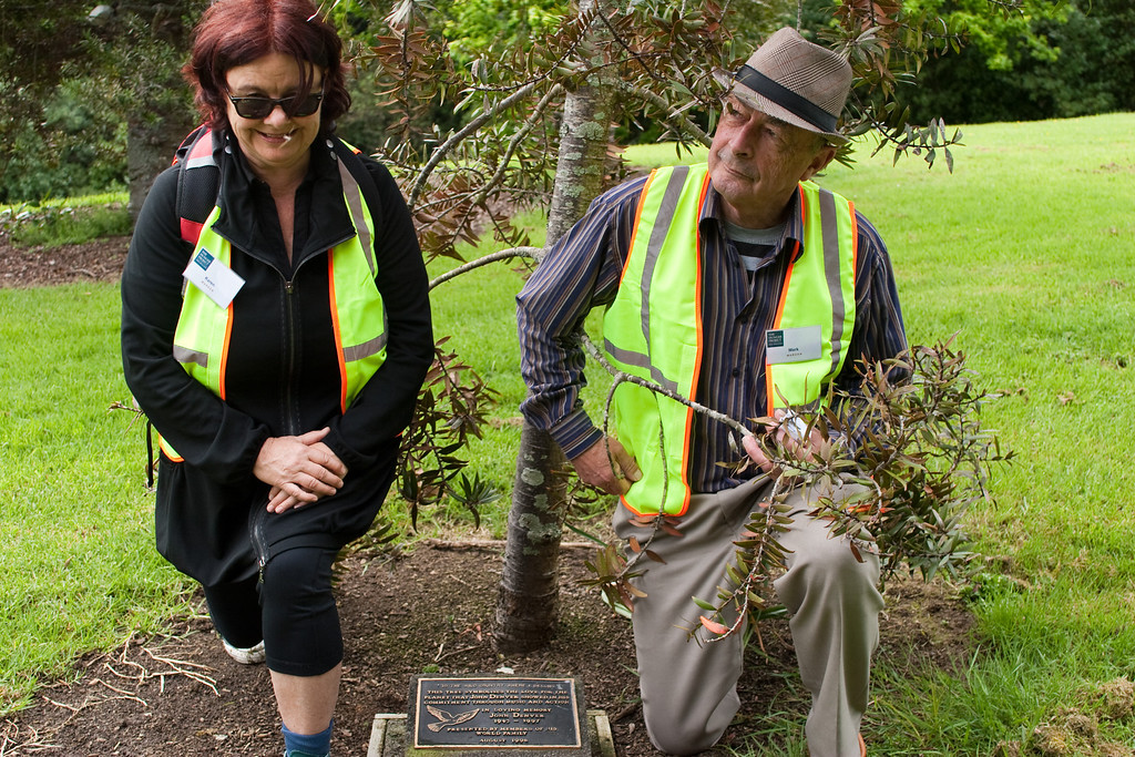 THP Hike_099-1 Karen Johns, Chair of the board of The Hunger Project, and Mark Hornblow, long time THP activist and supporter, with a plaque to John Denver in the domain. John Denver was one of the founders of the Hunger Project – and died in a plane crash just as he was about to attend the African Leadership Prize for the Sustainable End of Hunger - which some of us from New Zealand attended. Needless to say, apart from the tragedy of it we were rather disappointed to not be meeting him and hearing him sing live.