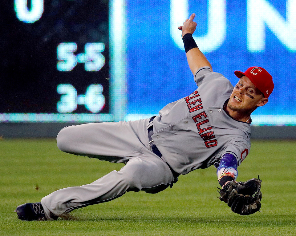 . Cleveland Indians right fielder Brandon Guyer catches a fly ball for the out on Kansas City Royals\' Jorge Bonifacio during the fifth inning of a baseball game Tuesday, July 3, 2018, in Kansas City, Mo. (AP Photo/Charlie Riedel)