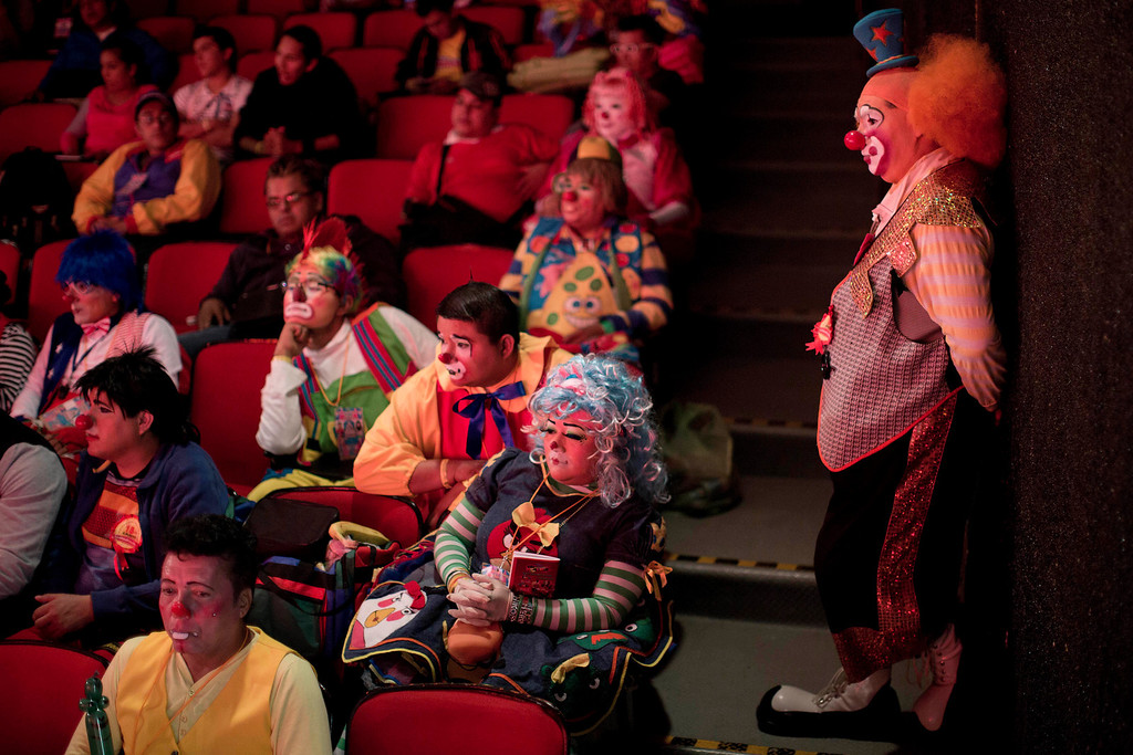 . Clowns listen during a workshop on the second day of the 17th International Clown Convention at a theater in Mexico City, Tuesday, Oct. 22, 2013. Hundreds of clowns from Mexico and Latin America gathered to brush up on their clown techniques and learn new laugh inducing tricks. (AP Photo/Dario Lopez-Mills)