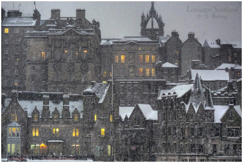 Old Town roofscape with falling snow