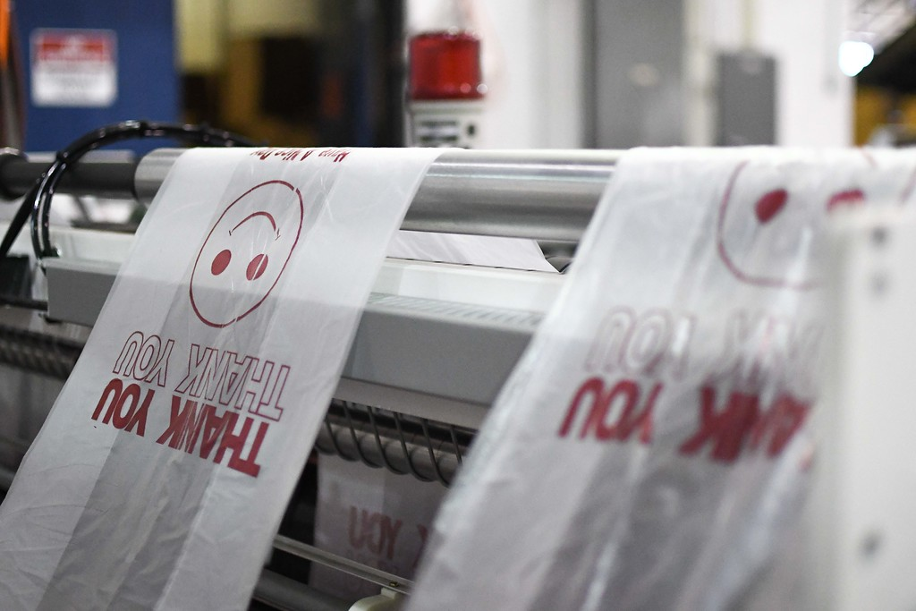 . Recycled plastic bags go through a machine where they are printed with a message at Global Plastic Technologies Inc., April 27, 2018. (Eric Bonzar�The Morning Journal)