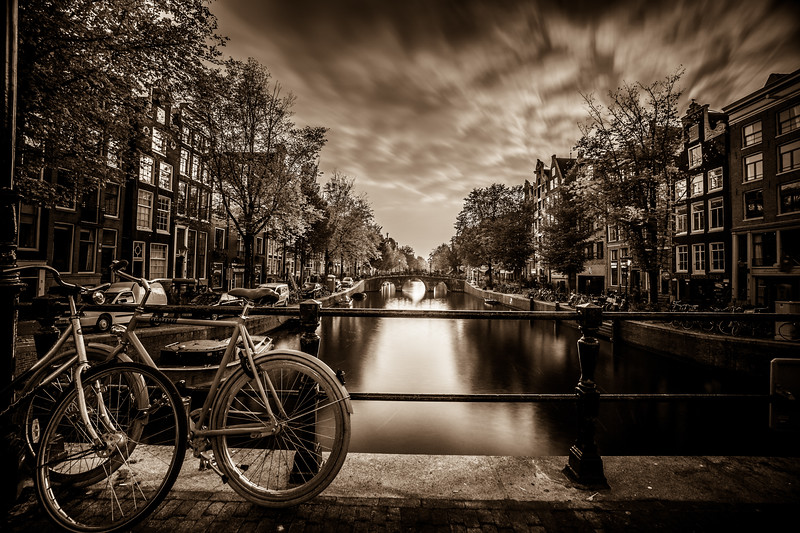 The romance of the canal of Amsterdam around sunset.