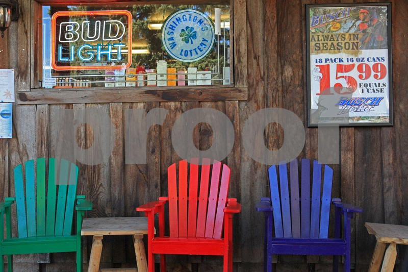 Brightly colored chairs set in front of a store in Glenwood, WA.