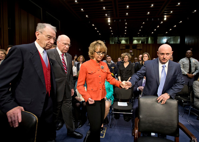 . Former Arizona Rep. Gabrielle Giffords, who was seriously injured in the mass shooting that killed six people in Tucson, Ariz. two years ago, arrives on Capitol Hill in Washington, Wednesday, Jan. 30, 2013, to speak  before the Senate Judiciary Committee hearing on what lawmakers should do to curb gun violence in the wake of last month\'s shooting rampage at that killed 20 schoolchildren in Newtown, Conn. She is escorted by her husband, Mark Kelly, right, a retired astronaut, Committee Chairman Sen. Patrick J. Leahy, D-Vt., second from left, and the committee\'s Ranking Republican, Sen. Charles Grassley, R-Iowa, left.  (AP Photo/J. Scott Applewhite)