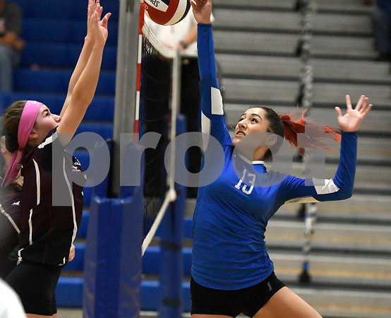 10/19/2017 Mike Orazzi | Staff Bristol Central's Peyton Greger (7) and Plainville's Isabel Lozefski (13) during Thursday's volleyball match in Plainville.