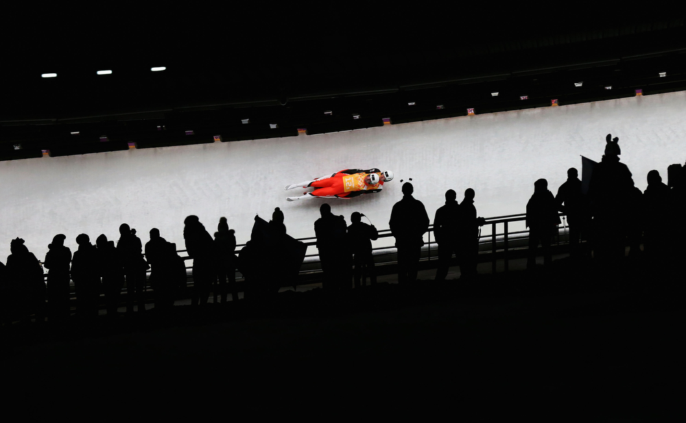 . Andreas Linger and Wolfgang Linger of Austria make arun during the Luge Relay on Day 6 of the Sochi 2014 Winter Olympics at Sliding Center Sanki on February 13, 2014 in Sochi, Russia.  (Photo by Alex Livesey/Getty Images)