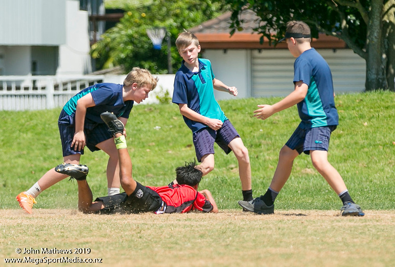 Images of the game between Point England (red) and St Thomas (blue) at the Eastern Zone Touch Tournament for boys, girls and mixed grades held at Madills Farm, Kohimarama, Auckland on 5 November 2019. Copyright: John Mathews 2019.   www.megasportmedia.co.nz