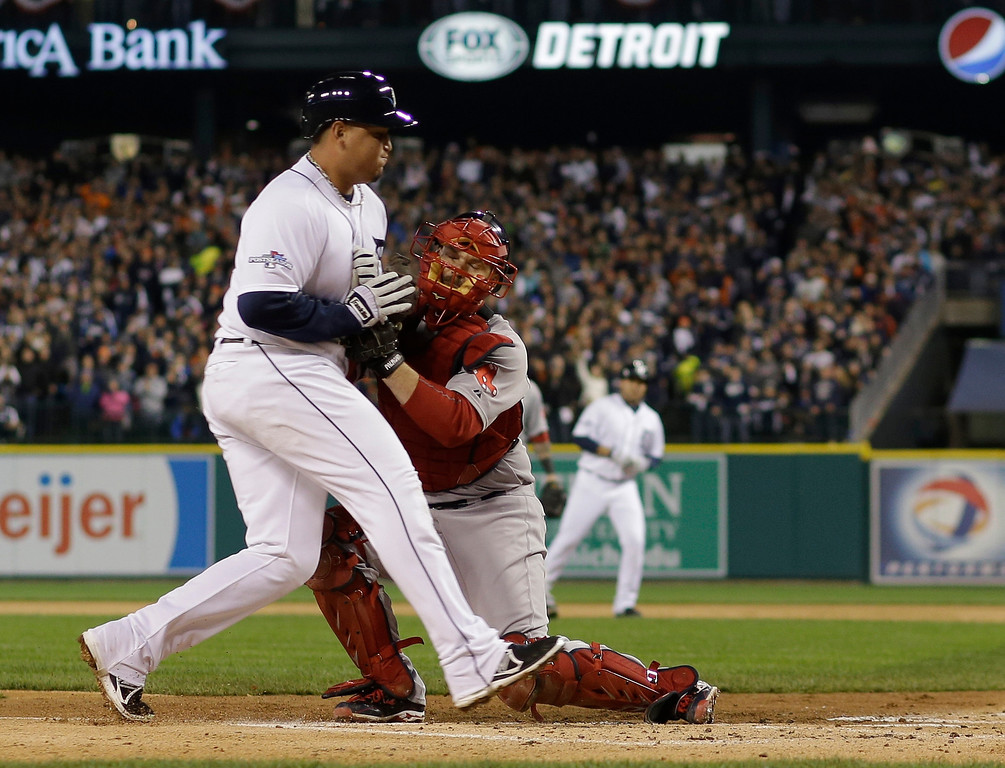 . Detroit Tigers\' Miguel Cabrera is tagged out at home by Boston Red Sox\'s David Ross in the first inning during Game 5 of the American League baseball championship series Thursday, Oct. 17, 2013, in Detroit.  (AP Photo/Matt Slocum)