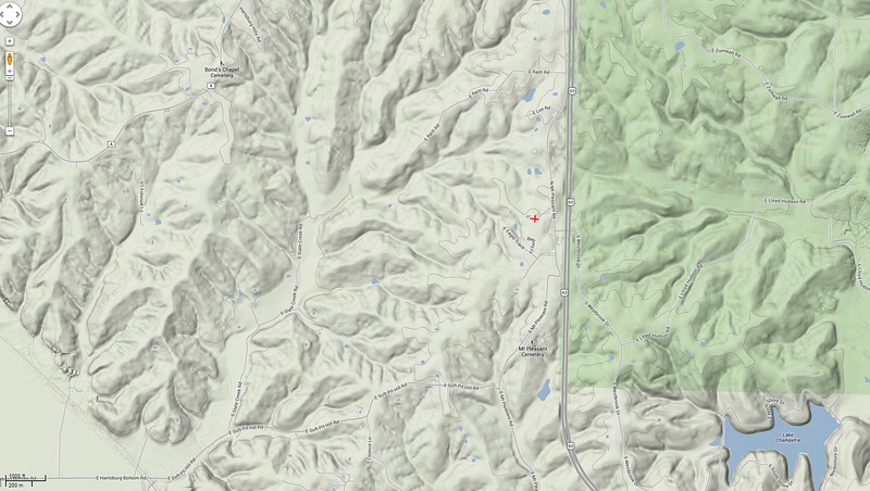 Topographical setting is a ridge top around 800 feet above sea level, with valleys draining down to around 600 feet, the level of the Missouri River Bottoms.