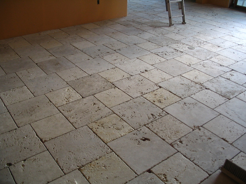 In this picture, you can really see how rough the natural travertine is. All those holes will be file with grout when it's done. We wanted a rough, natural look, and we certainly got it.