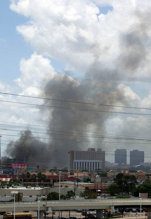 . The 5-alarm blaze at a restaurant and then engulfed a hotel as seen from the Westpark Tollway Friday, May 31, 2013, in Houston. Four firefighters searching for people they thought might be trapped in a blazing Houston motel and restaurant Friday were killed when the part of the structure collapsed and ensnared them, authorities said. (AP Photo/Houston Chronicle, Johnny Hanson)