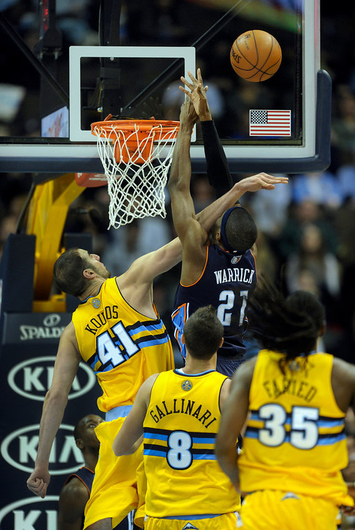 . Denver center Kosta Koufos (41) popped Bobcats forward Hakim Warrick (21) in the face as he tried to block a shot in the second half. The Denver Nuggets defeated the Charlotte Bobcats 110-88 at the Pepsi Center Saturday night, December 22, 2012.  Karl Gehring/The Denver Post