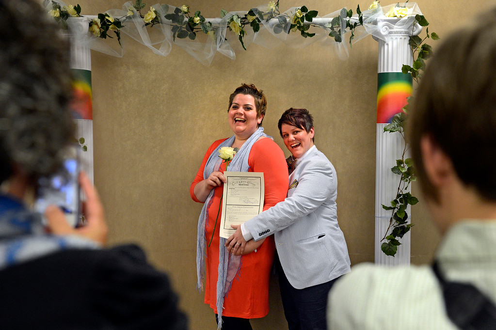 """. Andie Lyons, left, and her partner, Laurie Lynch, have their photo taken after receiving their civil-union license at the Clerk and Recorder\'s office. Although civil unions grant couples most of the same legal rights as marriage, Colorado voters banned same-sex marriages by approving a constitutional amendment in 2006. Denver Mayor Michael Hancock said it\'s time for that to change: \""""We will not stop until our state residents ... have full marriage equality under the law.\"""""""