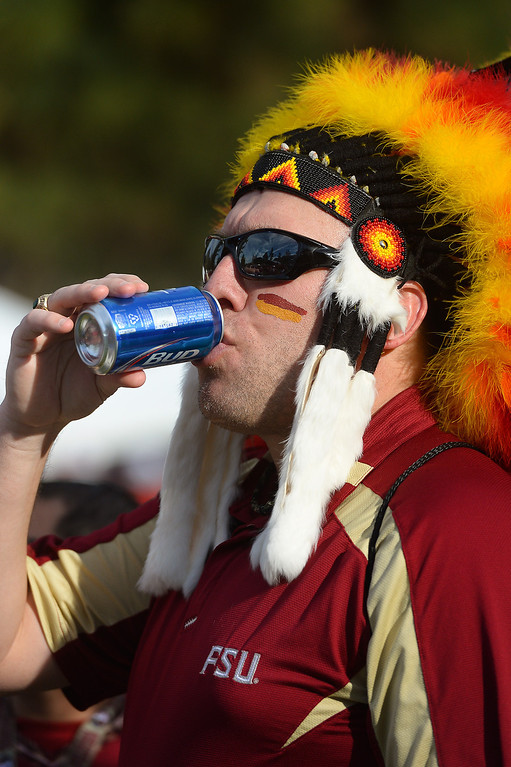 . Dave Phillips, from Panama City Florida, has a drink before the BCS game at the Rose Bowl, Monday, January 6, 2014. (Photo by Michael Owen Baker/L.A. Daily News)